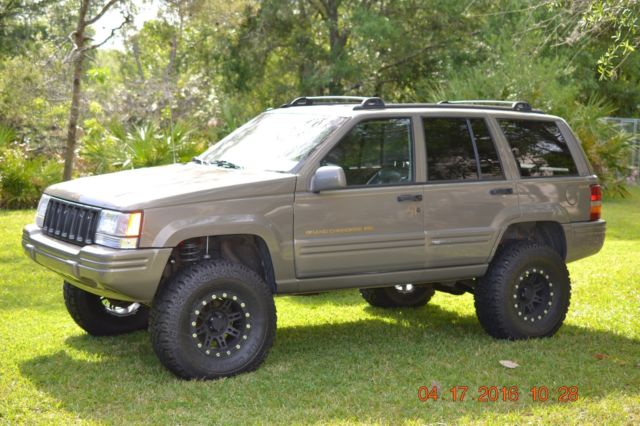 1j4gz78s2vc556555 1997 grand cherokee zj with 4 lift with brand new rims and tires. Black Bedroom Furniture Sets. Home Design Ideas