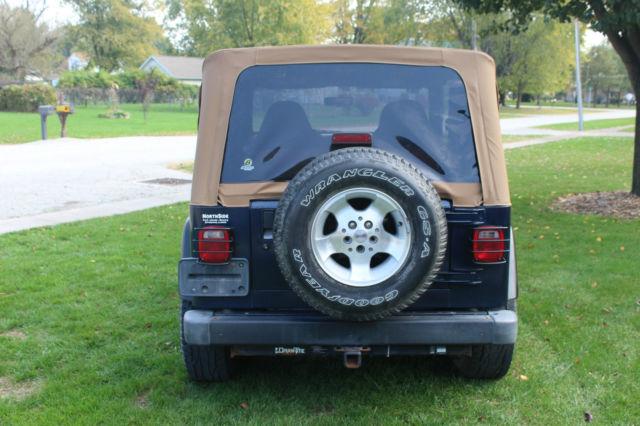 1j4fa49s8yp763769 2000 jeep wrangler sport sport utility 2 door 4 0l blue new top. Black Bedroom Furniture Sets. Home Design Ideas