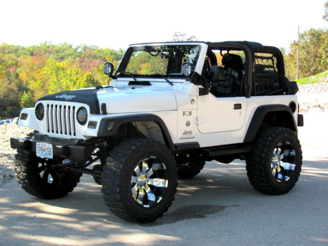 Lifted Jeep Wrangler X Tj Cyl Auto Trans X on Lift Car For Grocery