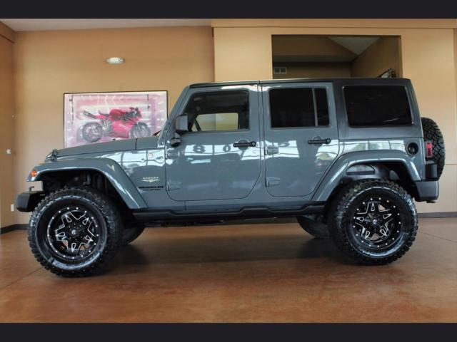1c4bjweg2el132973 2014 Jeep Wrangler Unlimited Sahara