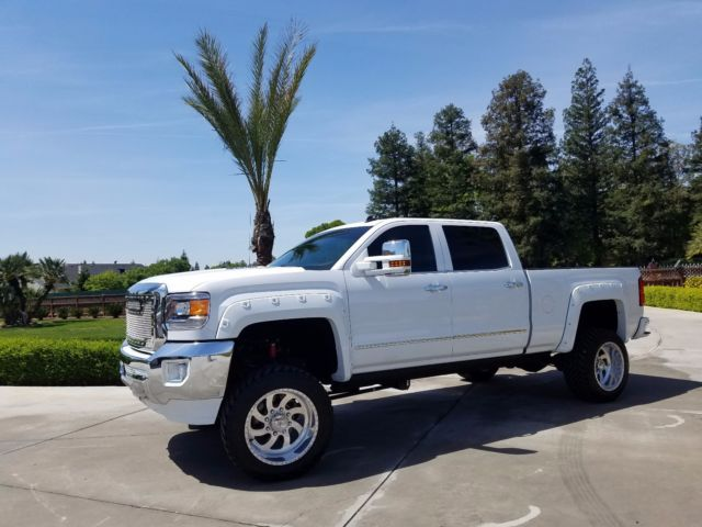 1gt12ze81ff105900 2015 gmc 2500 slt crew cab pick up lifted duramax diesel 4x4 custom not denali. Black Bedroom Furniture Sets. Home Design Ideas