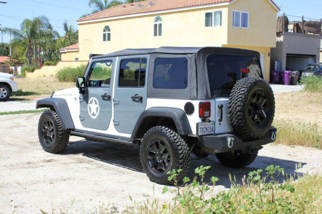 1C4BJWDG0FL713181   2015 Jeep Wrangler Unlimited Sport Utility 4 Door    Custom Parts   12k Miles