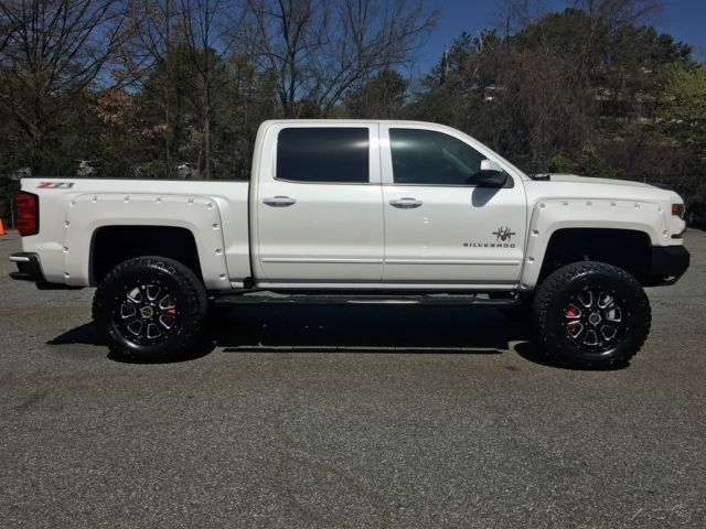 "New Smyrna Chevrolet >> 3GCUKREC8GG235481 - 2016 Silverado Z71 Crew 4wd Black Widow Pkg 6"" Lift LED Lights 20"" Wheels on 35s"